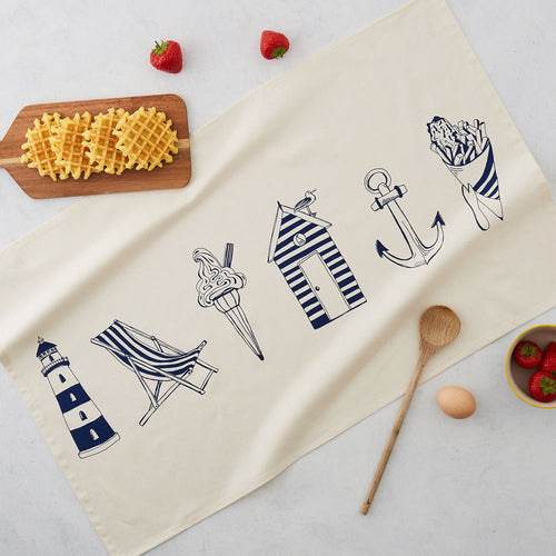 Tea towel with horizontal nautical design featuring large beach icons in navy, Nautical tea towel featuring large nautical icons in navy, Nautical kitchen towel featuring six large nautical icon designs in navy, Nautical dish towel featuring large nautical icons in navy