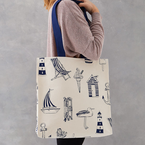 Canvas bag featuring repeating design of large nautical icons in navy, Navy and eggshell canvas bag featuring nautical icons, Hand illustrated canvas bag featuring beachscape designs in navy