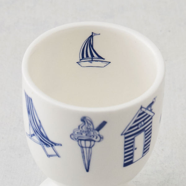 Nautical design egg cups featuring repeating pattern of navy nautical icons, Fine bone china egg cups featuring repeating nautical design, Navy and white nautical egg cups featuring hand illustrated nautical icons