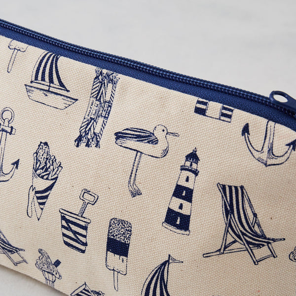 Cosmetic bag featuring repeating nautical design in navy, Pencil case featuring nautical design of repeating beachscape icons, Small nautical travel bag featuring repeating design of iconic nautical designs in navy