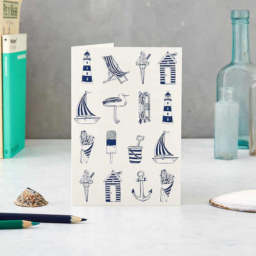 Greeting card featuring repeating nautical design in navy and white, Nautical greeting card featuring nautical icons such as a sailboat and light house, Navy nautical design greeting card featuring repeating nautical icons design