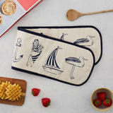 Double oven glove featuring nautical design in navy and eggshell, Double kitchen oven glove featuring nautical design in navy, Nautical oven glove featuring designs such as a sailboat and seagull