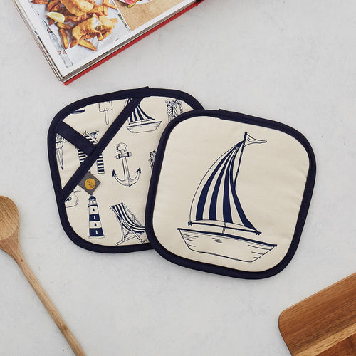 Nautical pot grab featuring repeating nautical icons design in navy, Double sided kitchen pot grab featuring large sailboat design and repeating nautical icons design in navy, Nautical navy pot grab featuring repeating pattern of nautical icons such as an anchor and sailboat