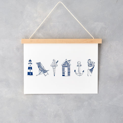 Wall print featuring hand-illustrated nautical designs in navy and white, Nautical wall print featuring iconic beach design in navy and white, Lighthouse and anchor wall print in navy, Horizontal wall print featuring navy and white nautical design
