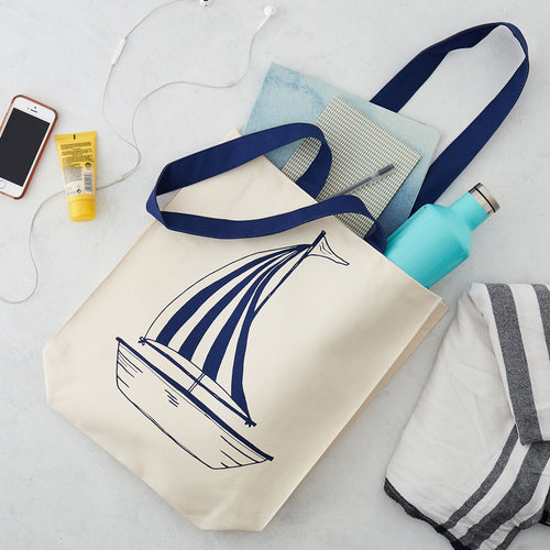 Double sided canvas bag featuring nautical design of an anchor and sailboat, Nautical canvas bag featuring both an anchor and sailboat design in navy, Reusable nautical bag featuring large anchor and sailboat design in navy
