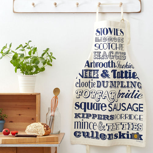 Apron featuring navy repeating pattern of traditional Scottish meals, Unisex apron featuring repeating typography design of traditional Scottish meals, Navy apron featuring repeating pattern of different Scottish meals