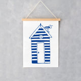 Wall print featuring navy striped beach hut and seagull design, Striped navy beach hut wall print, Hanging wall print featuring navy beach hut and seagull design