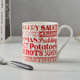 Fine bone china mug featuring repeating design of traditional Christmas dinner items, Red fine china mug featuring Christmas dinner items, Small fine bone china mug featuring Christmas dinner items, Mug featuring red typography of traditional Christmas meal items