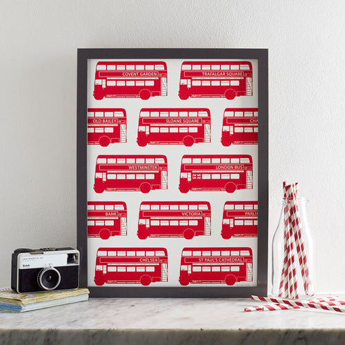 Wall print featuring repeating design of red London double-decker bus, Wall print featuring red double-decker bus, wall print featuring repeating London bus pattern, Red wall print featuring hand-illustrated London bus design