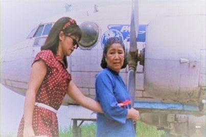 A middle-aged woman guiding a blind young girl