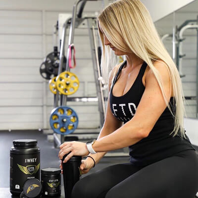 Woman using the best fitness supplements after a workout