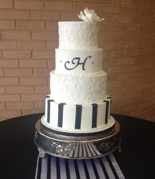 4-tier white and black wedding cake