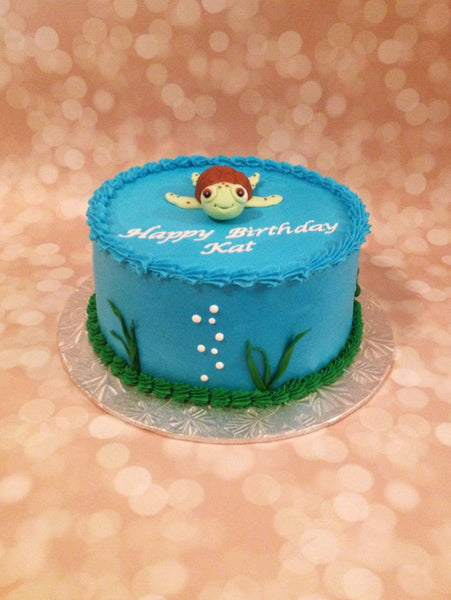 Blue 1-tier birthday cake with 3D turtle