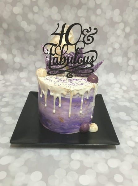 Purple 40 and fabulous double barrel drip birthday cake