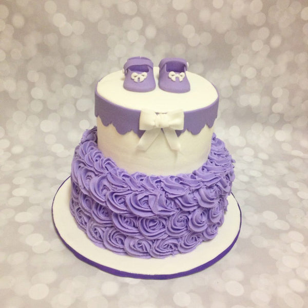 Purple roses and booties 2-tier baby shower cake