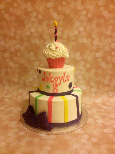 Stripes and polka dots 2-tier birthday cake with cupcake topper
