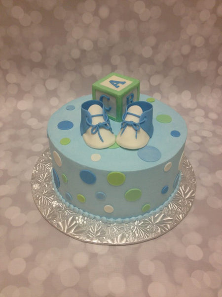Blue polka dot 1-tier baby shower cake with 3D toppers