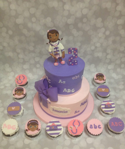 Doc McStuffins 2-tier cake with 3D character and cupcake toppers
