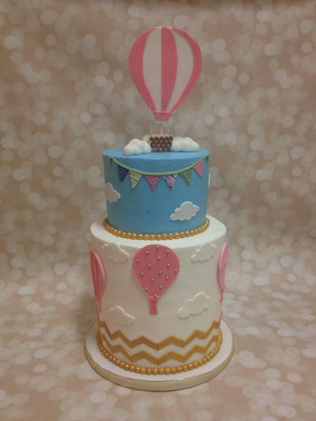 Hot air balloon 2-tier double barrel baby shower cake