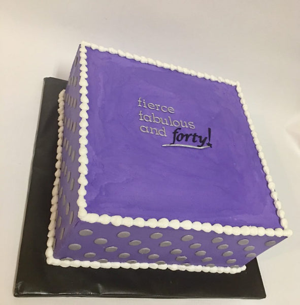 Purple 1-tier 40th birthday cake with polka dot sides