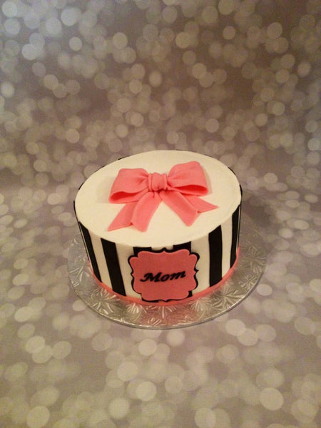 Striped black and pink 1-tier birthday cake with 3D bow