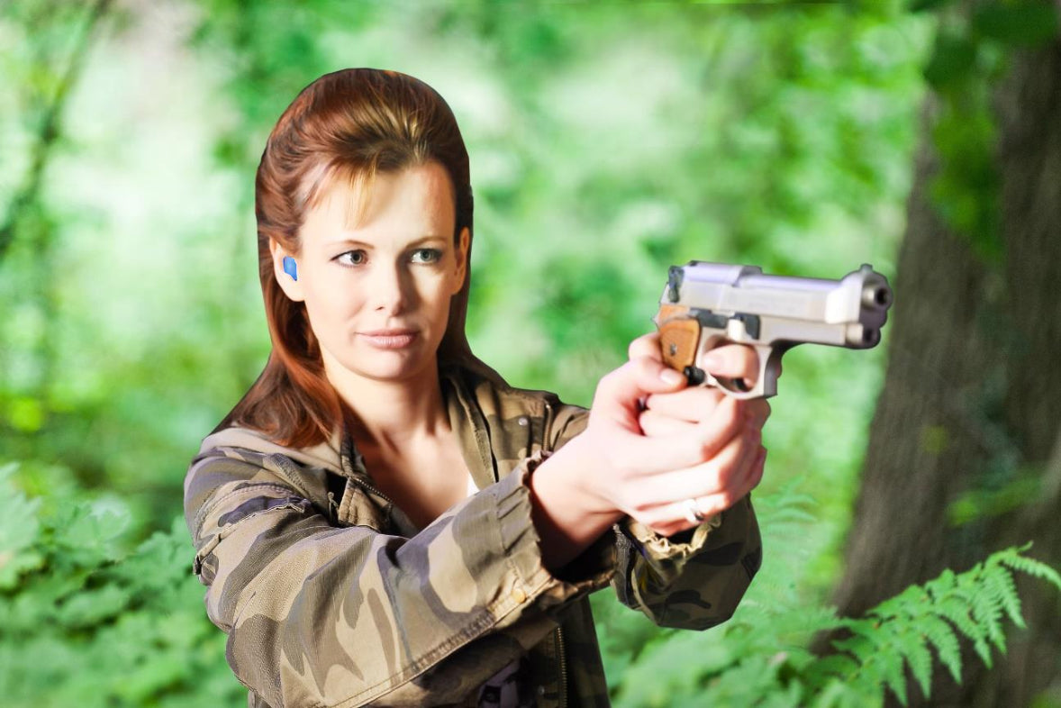 red hair pretty woman with gun in hand