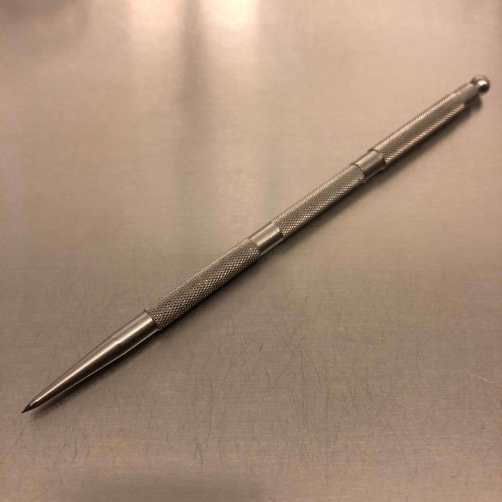Stainless-steel pencil with tungsten carbide point and protective cap.