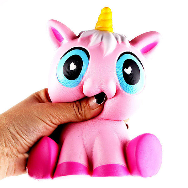 Hand squeezing unicorn squishy