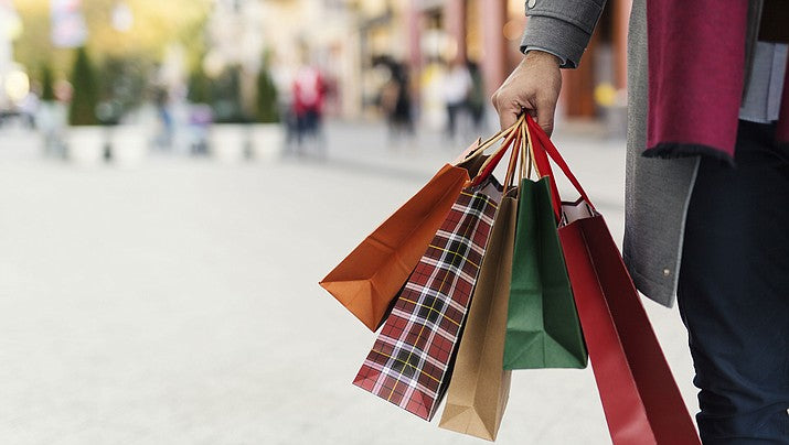Woman carrying shopping bags while Christmas shopping