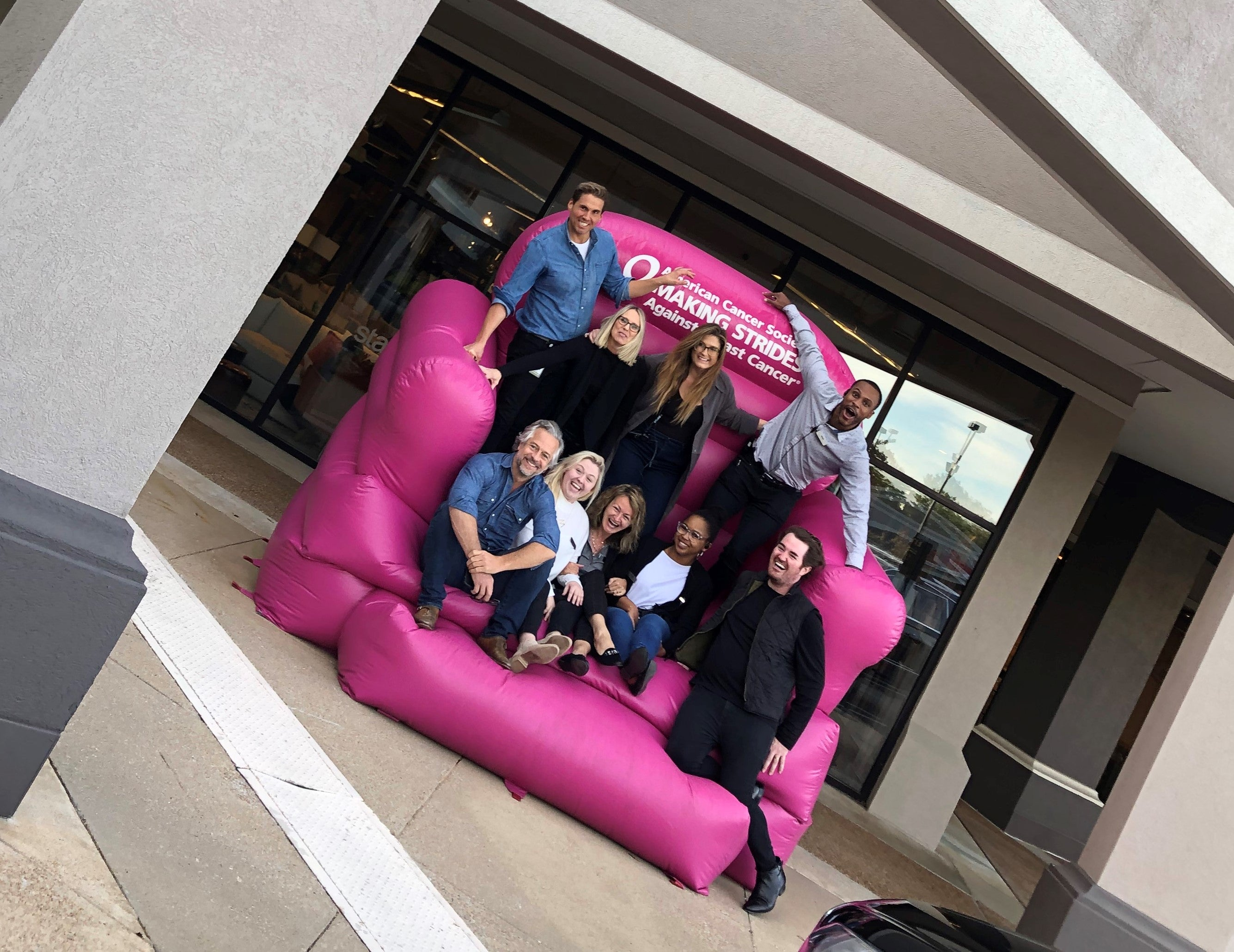 Employees at Stash Home Memphis in Big Pink Chair Making Strides Against Breast Cancer