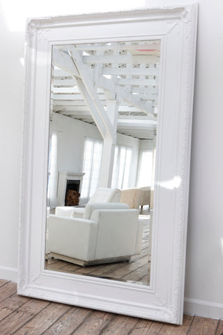 Large White Mirror Leaned Against Wall
