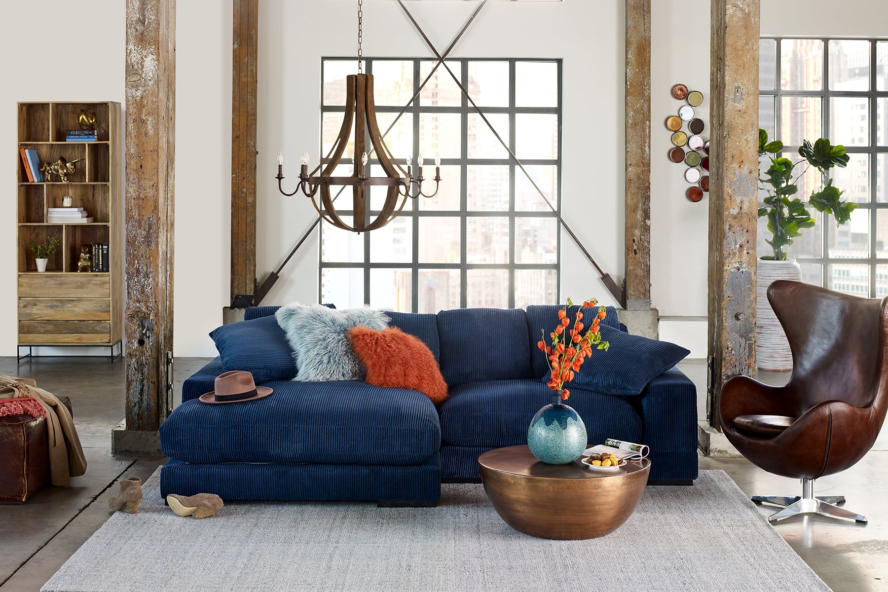 Moe's Plunge Sectional with orange and blue pillows