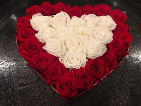 Heart Shape Forever Approximately 36 petite long lasting roses in a Valentine's candy box