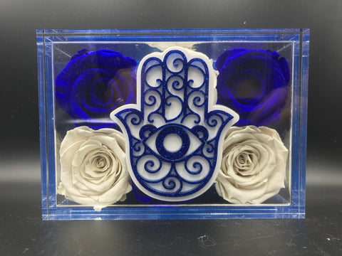 Hamsa 5x7 lucite with 6 to 8 long lasting roses. Roses last 6 months to over a year