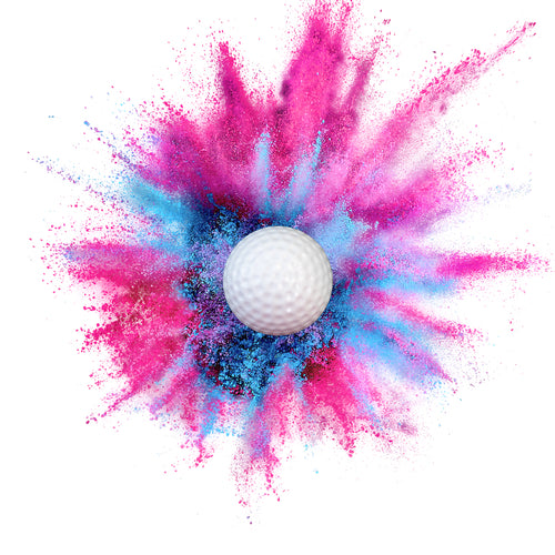 pink or blue golf ball filled with color powder for gender reveal party