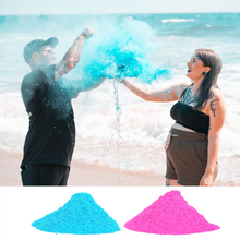Load image into Gallery viewer, man and woman on beach with blue powder for gender reveal. pink or blue, non-toxic biodegradable