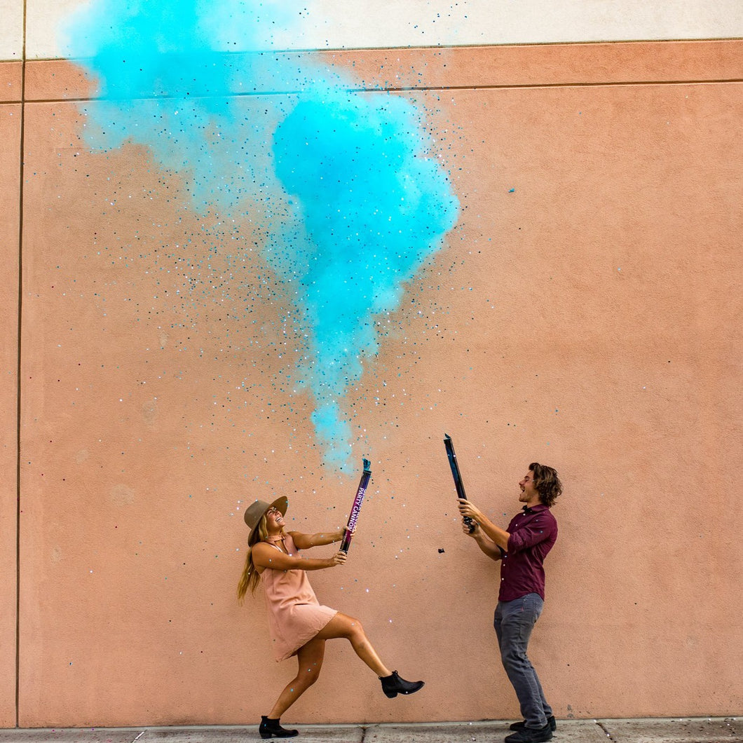 its a boy gender reveal party cannon with powder smoke and confetti