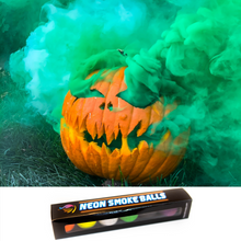 Load image into Gallery viewer, smoking pumpkin with product photo of neon smoke balls. wick-activated, non-toxic smokes that last 15 seconds