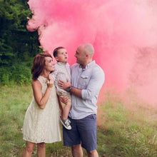 Load image into Gallery viewer, family holding baby with pink smoke behind them at their gender reveal. non-toxic gender reveal smoke balls, pack of 6