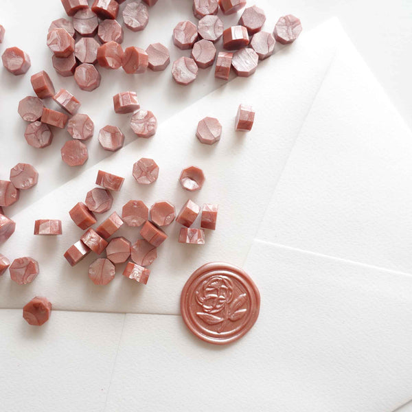 Antique rose gold sealing wax beads with peony wax seal on envelope Australia