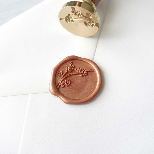 Cherry blossom sakura wax seal in peach copper with stamp on envelope