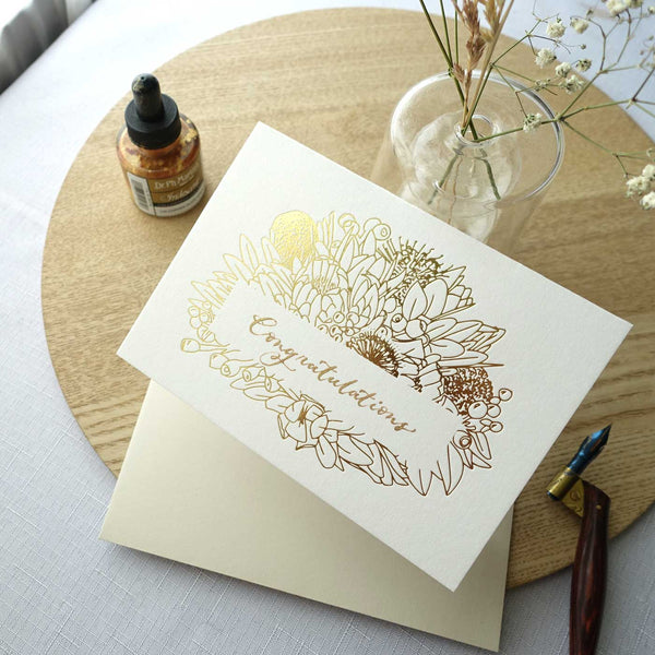 Gold foiled greeting card with Congratulations handwritten in calligraphy