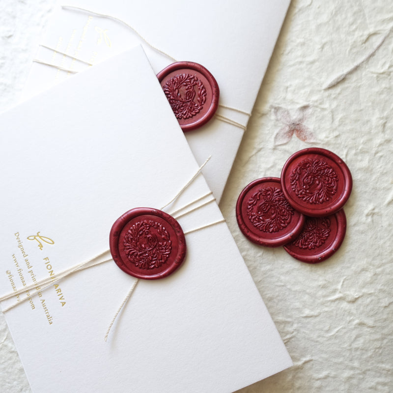 Burgundy wine song bird wax seals wedding invitations