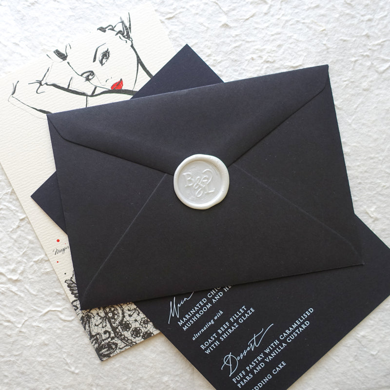 Monogram wedding wax seal on black envelope