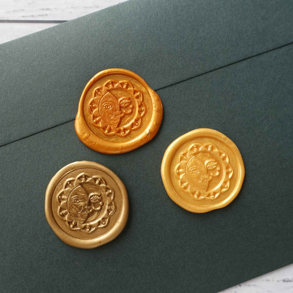 Sun and Moon bronze yellow amber gold wax seals on envelope