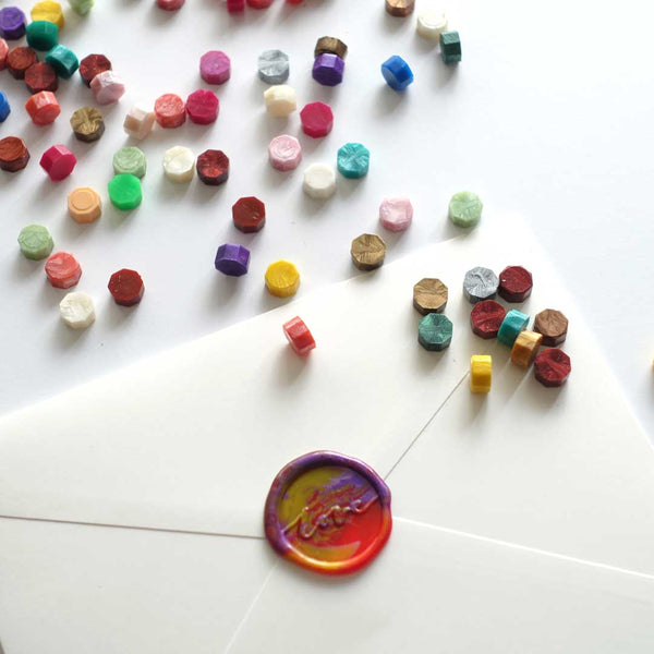 Multicolour mixed wax seals on envelope with love stamp