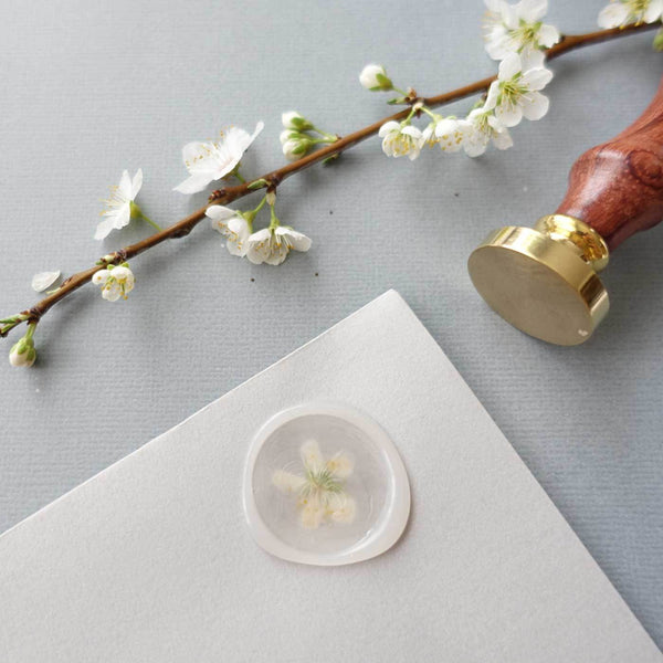 Semi transparent wax seal with flowers and blank wax stamp