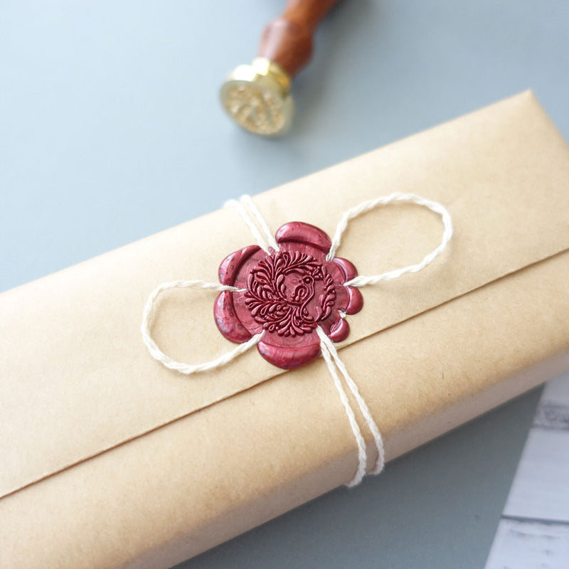 Bird peacock wax seal idea with twine on gift wrapping present