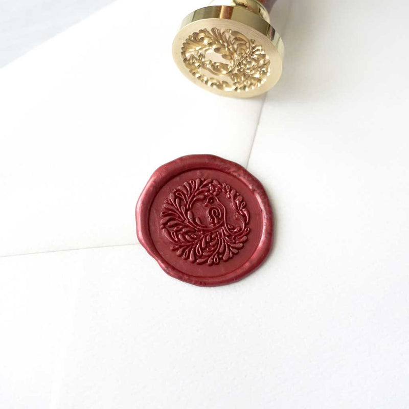 Song bird peacock burgundy wine wax seal stamp on envelope