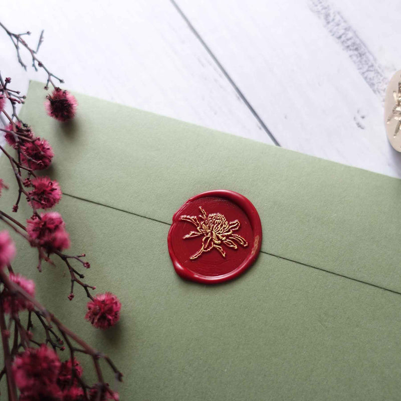 Waratah flower crimson red wax seal on olive green envelope
